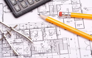stock house plans with calculator and pencil